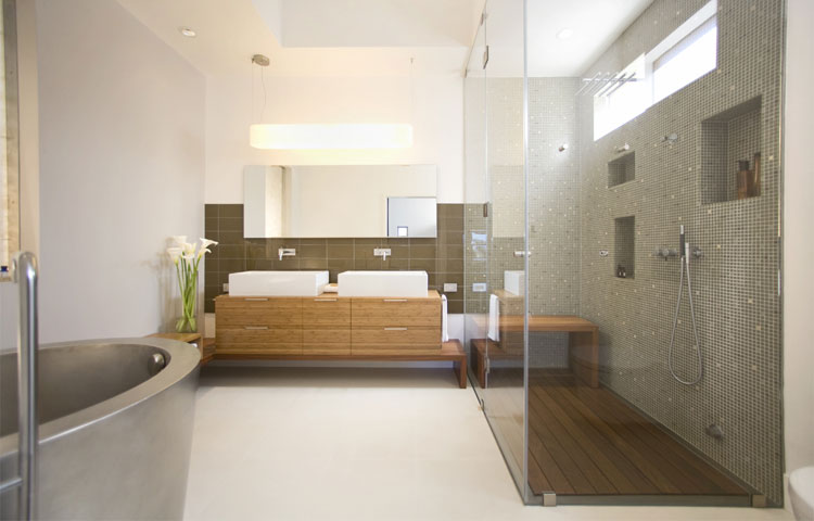 master bathroom with stainless soaking tub and steam shower
