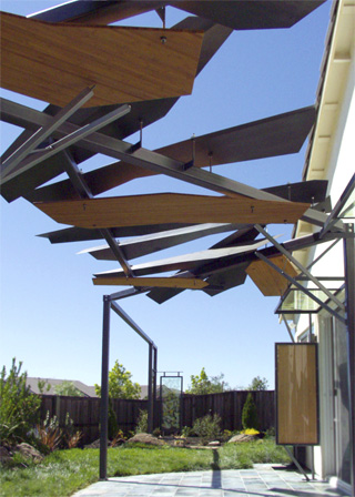 outdoor canopy sculpture of steel, bamboo plywood and glass panels encapsulating either colored leaves or cherry wood veneers.